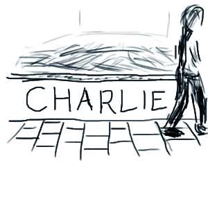 Schets van de tekst Charlie op een muurtje langs een weg van tegels